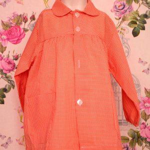 Babi escolar 009 de cuadros naranja con nombre bordado